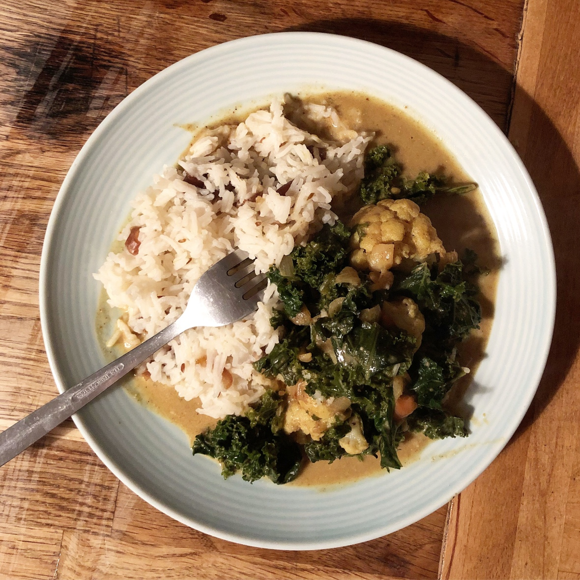 Kale and Cauliflower Coconut Curry with Clove, Cumin and Date Rice